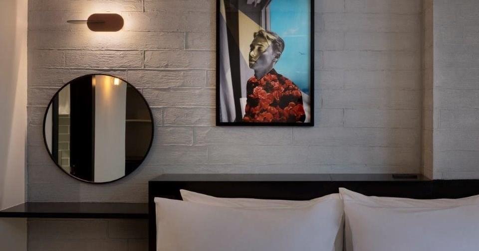 אומנות של הגרה - חדרי מלון מיוז